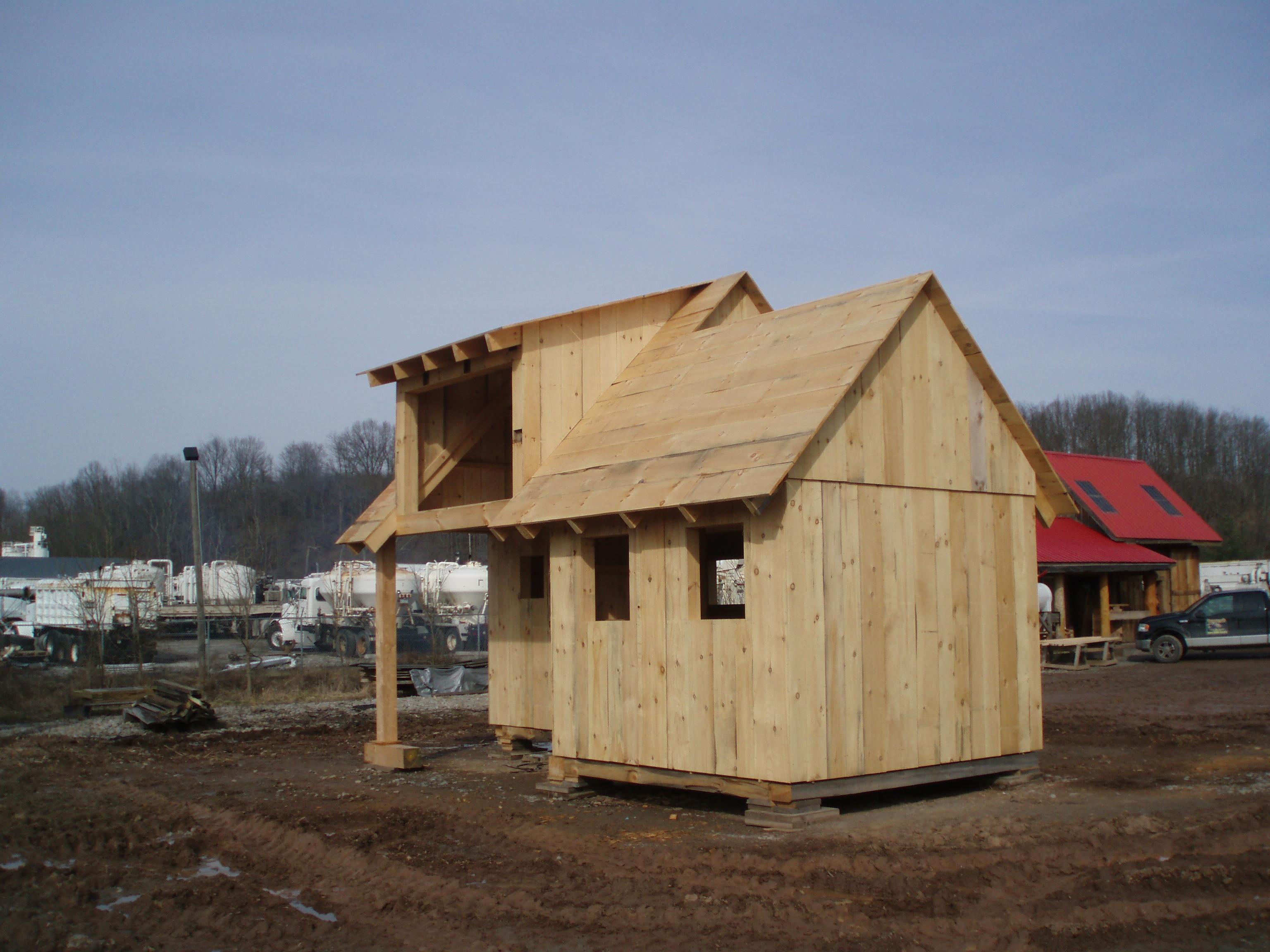 Tamarack log and timber homes shed dormer porch for Shed with dormer